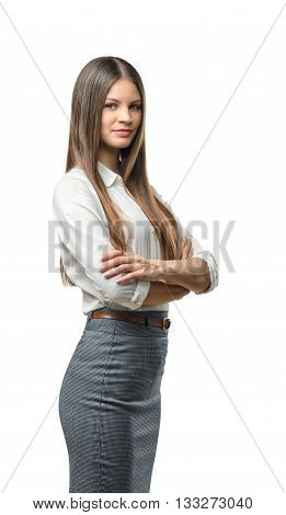 Cutout business woman with folded arms looks directly at the camera. Smart staff. Success and development. Business staff. Office clothes. Dress code. Presentable appearance.