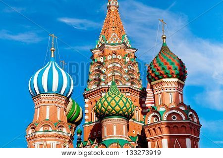St. Basil's Cathedral on Red square in Moscow, Russia. Domes of cathedral against blue sky. Close up view of Moscow St. Basil's Cathedral