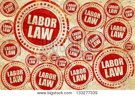 labor law, red stamp on a grunge paper texture