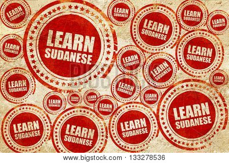 learn sudanese, red stamp on a grunge paper texture