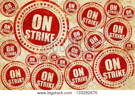 on strike, red stamp on a grunge paper texture