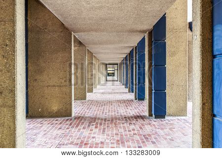London, UK - June 3, 2016 - Brutalist architecture pedestrian hallway in the Barbican Complex London