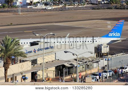 Eilat, Israel - MAY 24: plane of israeli airline Arkia, landed at the airport of Eilat on the background of luxurious hotels, Israel, on May 24, 2016 in  Eilat, Israel