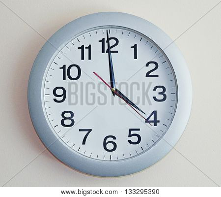 Wall Clock. White number clock with arrows.