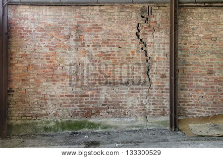 old weathered cracked facade brick wall background