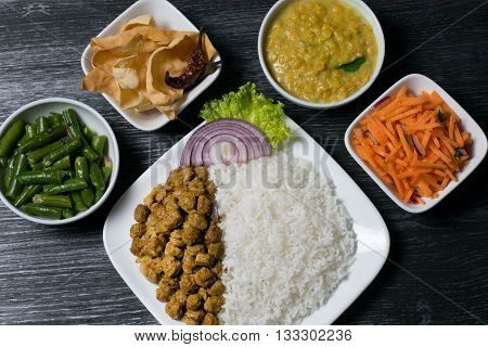 Sri Lankan rice and curry on dark background