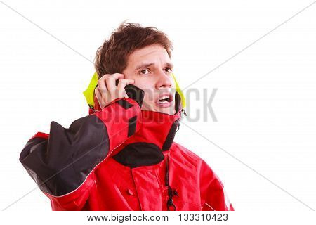 Man in hood with phone. Young male in waterproof coat talking on cellphone. Adventure danger connection technology concept.