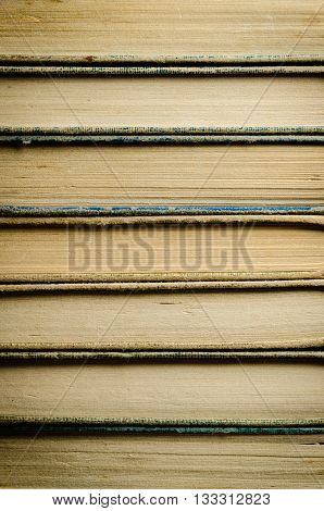 Abstract image of many old books stacked up