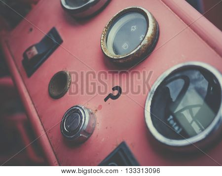 A view of the dashboard or instrument panel of an old vintage and antique car