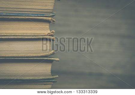 Image of many antique books stacked up together