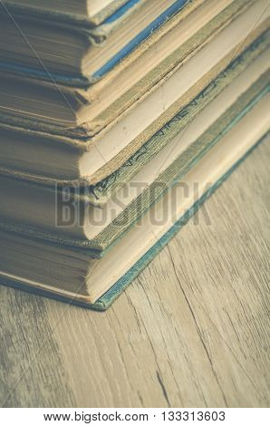 Image of the corners of many old books stacked up