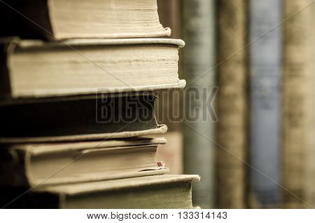 Image of several old books stacked on top of each other