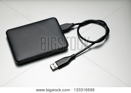External hard drive for backup on gray background