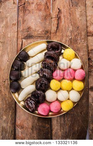 Gulab Jamun or kala jamun, khoya jalebi or black jalebi and Chum Chums or multicolour rassgulla or rasagulla, famous bengali sweets poster