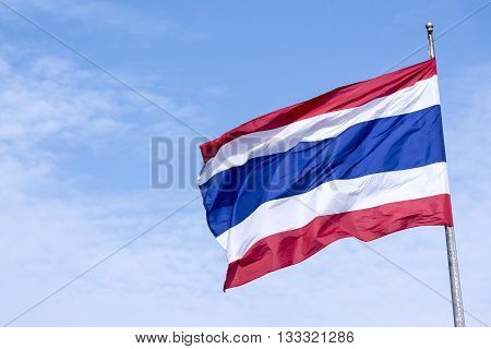 the national flag of Thailand blow at the flag pole.Thailand national flag with the blue sky.The national flag of Thailand with the sky.The Thailand flag waving with the sky.Beautiful Thailand flag.