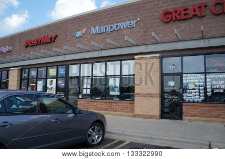 SHOREWOOD, ILLINOIS / UNITED STATES - AUGUST 16, 2015: One may find temporary jobs at Manpower, in a strip mall in Shorewood.