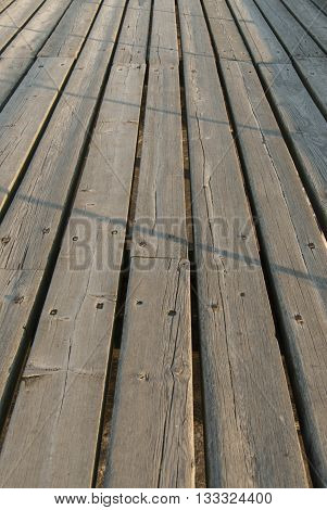 Old Walkways With Weathered Wooden Planks Showing Bleaching Due To Sun And Rain.