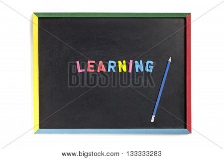 View Of A Slateboard With Learning And Pencil On It