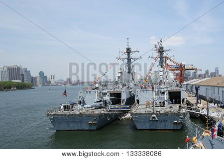 NEW YORK - MAY 26, 2016: US Navy guided-missile destroyers USS Bainbridge and USS Farragut docked in Brooklyn Cruise Terminal during Fleet Week 2016 in New York. Manhattan Sky Line on the background