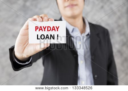 Businessman Presenting Business Card With Word Payday Loan