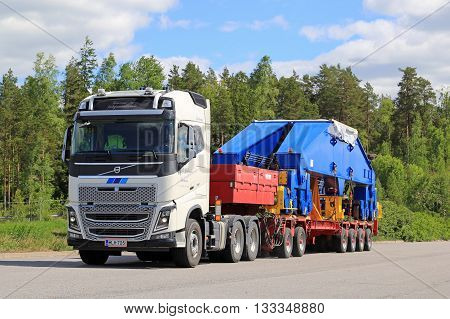 PAIMIO FINLAND - JUNE 4 2016: White Volvo FH16 750 transports shipyard crane bogie on trailer. The 48-tonne load is supported by 24 wheels.