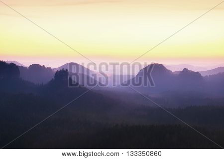 Tourist Resort. Fantastic Dreamy Sunrise On The Top Of The Rocky Mountain With The View Into Misty V