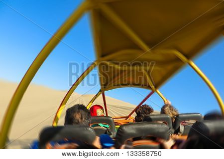 Extreme sand buggy ride in the desert with camera shake