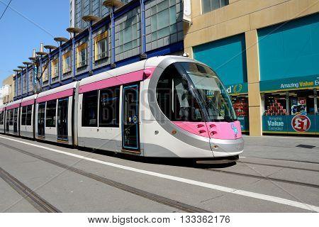 BIRMINGHAM, UK - JUNE 6, 2016 - Midland Metro city centre extension Tram along Corporation Street Birmingham England UK Western Europe, June 6, 2016.