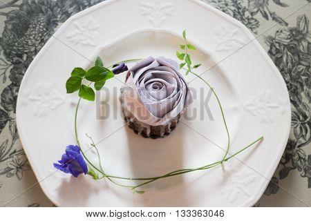 Romantic violet rose homemade cup cake stock photo