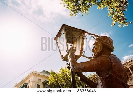 Statue Of Old Lamplighter, Igniting Lights On Streets Of Tbilisi - The Capital Of Georgia.