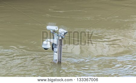 Surveillance camera on the top of a pole are almost covered by water on the River Seine embankment after the massive flooding in Paris during the first days of June 2016.