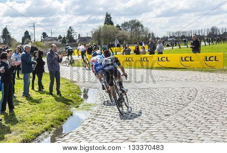 Hornaing France - April 102016: The peloton riding on a paved road in Hornaing France during Paris Roubaix on 10 April 2016.