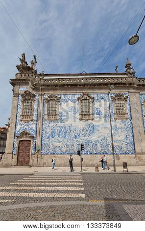 PORTO PORTUGAL - MAY 26 2016: Azulejo tiles on the side wall of Carmo Church (18th c.) in the historical center of Porto (UNESCO site). Work of Silvestro Silvestri