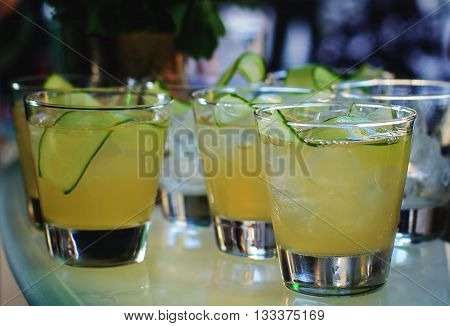 lot of glasses with a delicious cocktail