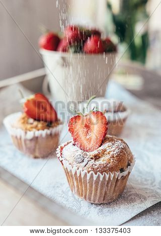 Cupcake with fresh stawberry powder with sugar