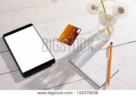 Credit Card, Tablet And Notebook With Pencil On The Table