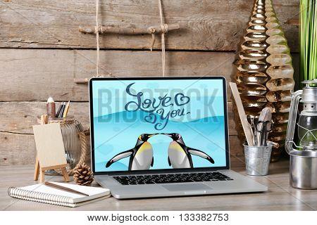 Workplace. Retro design concept. Laptop with screensaver