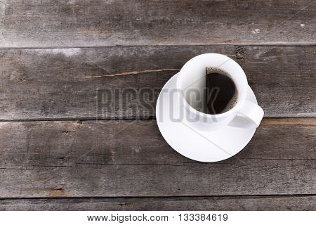 half cup of coffee on wooden table with copysace