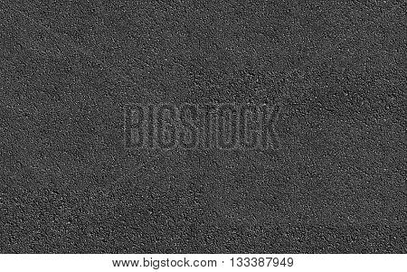 Dark rough asphalt road texture background pattern