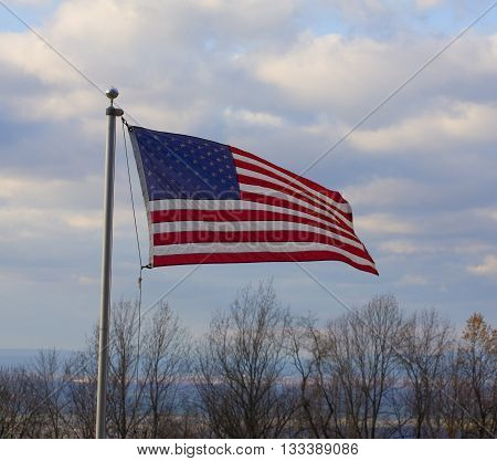 American flag waving atop the Blue Ridge over the Shenandoah Valley