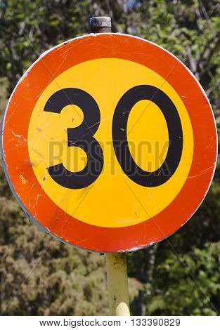 a sign stipulating the speed limit to 30k per hour