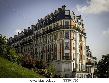 PARIS, FRANCE - MAY 17, 2016: With its distinctive European architecture, this residential apartment building overlooks the affluent Montmartre district in the 18th Arrondissement of Paris.