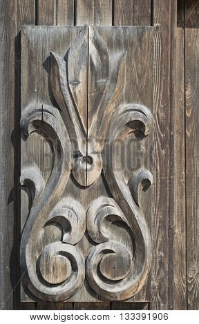 wooden unprofitable carving on the door of the old house
