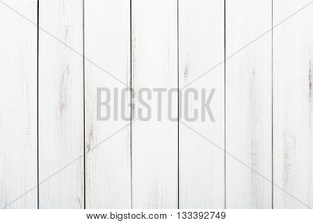 White wood table texture and background. White painted wood texture background. Rustic, shabby chick wooden background. Aged wood planks pattern. Wooden surface. Vertical timber texture