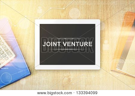 joint venture word on tablet with soft light vintage effect