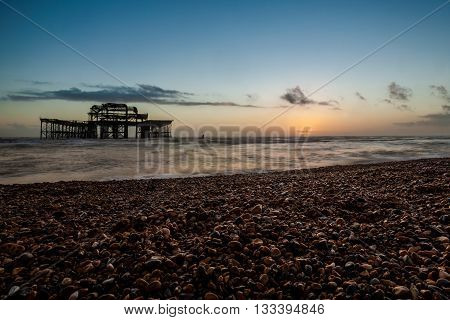 Sunset View On Old Brighton Pier And Beach