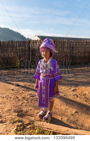 Chiangmai - THAILAND - JAN 1 2016 : Hmong hill tribe girl in traditional dress beautiful purple in Hmong villageChiangmaiTHAILAND on January 1 2016