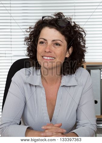 Casual business woman with arms crossed smiling