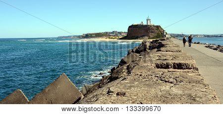 Walking from the Breakwall back to Nobbys Lighthouse