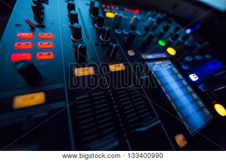 DJ console mixing desk at the night club